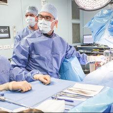 Neurochirurgie Thumb
